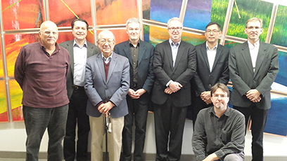 Members of the Accelerator Systems Advisory Committee are, from left, Joseph Bisognano, Thomas Roser, Satoshi Ozaki, Bob Laxdal, Stuart Henderson, Roberto Than, Kay Kasemir (kneeling), Jens Knobloch.