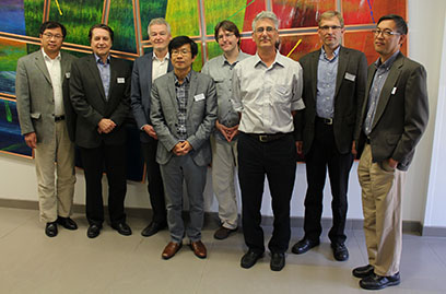The ASAC Review Committee (left to right): Yuke Tian, Thomas Roser, Bob Laxdal, Sang-ho Kim, Kay Kasemir, John Galambos, Jens Knobloch, and Yatming Than. Stuart Henderson was not present.