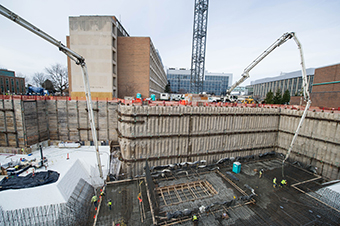 Workers place concrete for the floor of the target area on December 1.