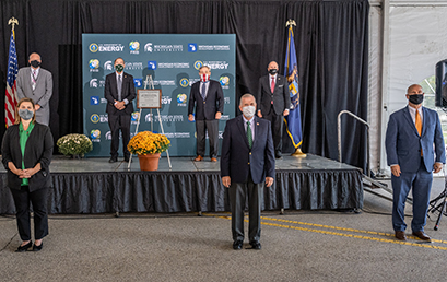 U.S. Secretary of Energy Dan Brouillette (back row, third from left) designated the Facility for Rare Isotope Beams as a U.S. Department of Energy (DOE) Office of Science user facility 29 September. Pictured above at the event are: (Front row, left to right) U.S. Representative Elissa Slotkin of Michigan, U.S. Representative Tim Walberg of Michigan, U.S. Representative John Moolenaar of Michigan; (back row, left to right) FRIB Laboratory Director Thomas Glasmacher, MSU President Samuel L. Stanley Jr., M.D., Secretary Brouillette, and DOE Under Secretary for Science Paul Dabbar.