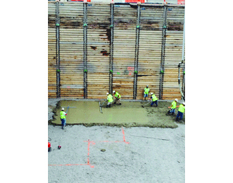 Workers pour the first concrete for the FRIB tunnel.