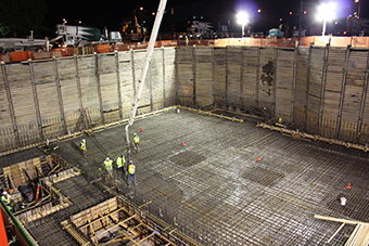 Workers place 1,400 cubic yards of concrete for the linear accelerator tunnel.