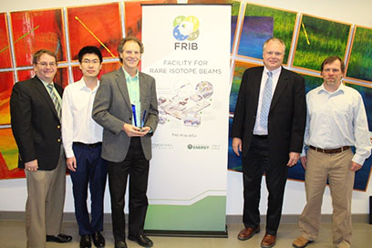 FRIB hosted a special recognition event to honor the MSU College of Engineering's support of FRIB. Pictured, from left, are College of Engineering Dean Leo Kempel, FRIB graduate student Di Kang, Professor Thomas Bieler of the Department of Chemical Engineering and Materials Science, FRIB Laboratory Director Thomas Glasmacher, and FRIB Cavity Fabrication Group Leader Chris Compton.