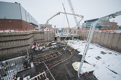 Workers place concrete for the linear accelerator tunnel foundation slab during the largest concrete placement of the entire FRIB Project, which took place March 3-4.