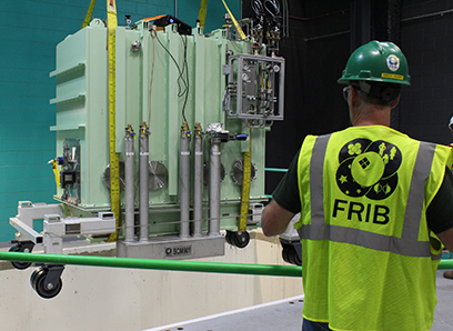 FRIB Project personnel placed the first and only β=0.085 matching cryomodule in the linear accelerator tunnel on 17 July.