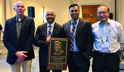 MSU Cryogenics Initiative Director Venkatarao Ganni (second from left) receives the 2019 Samuel C. Collins Award. Pictured from left: Senior Cryogenic Process Engineer Peter Knudsen, Ganni, Cryogenic Process Engineer Nusair Hasan, and FRIB Accelerator Systems Division Director Jie Wei.
