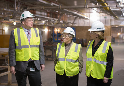 FRIB Project Director Thomas Glasmacher (left) talks with MSU President Lou Anna K. Simon and Senator Debbie Stabenow (right) during a tour of the FRIB construction site on 22 December. Photo by Greg Kohuth, MSU Communications and Brand Strategy