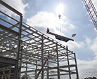 Raise high the beam; SRF Highbay showing progress