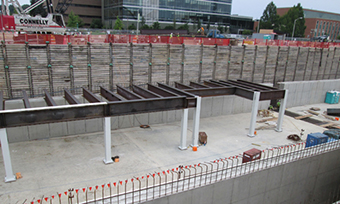 Workers install structural steel for the top of the linear accelerator tunnel.