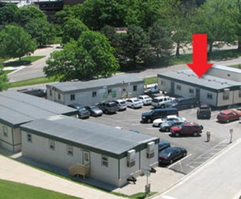 The newest construction trailer (indicated with arrow) provides more office and meeting space as the Conventional Facilities Division prepares for final design of civil construction.